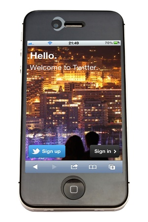 displayed: Twitter displayed on an iPhone 4s screen Editorial