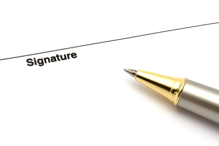 Pen isolated on a blank signature paper   photo