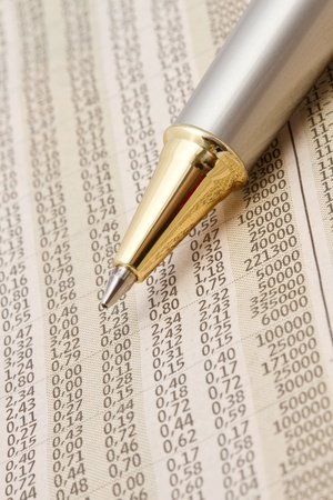 Analyzing the stock market with a pen   photo