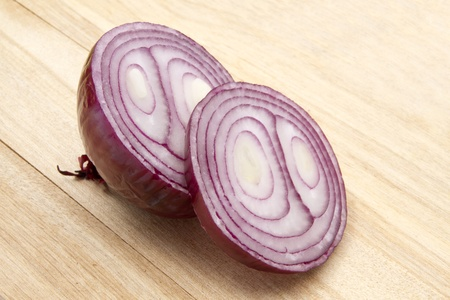 Red onion isolated on wood background   photo