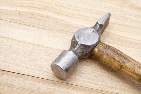 Old hammer isolated on wood background   photo