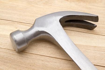 Hammer isolated on wood background photo