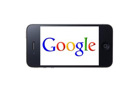 google: Logotipo de Google que aparece en la pantalla del iPhone Editorial