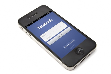displayed: Facebook login page displayed on Apple iPhone screen