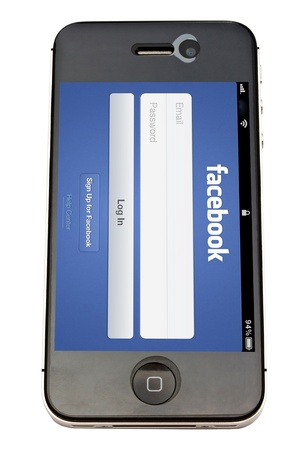 Facebook website displayrd on iphone screen Stock Photo - 12386036
