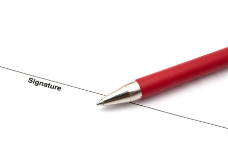 A pen isolated on a blank signature paper  photo