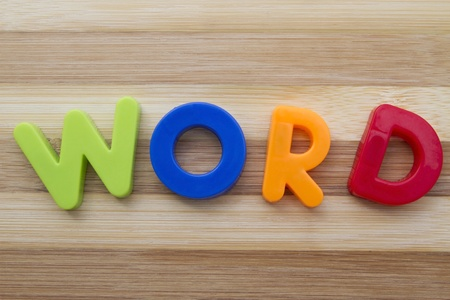 learing: Letter magnets WORD closeup on wood background
