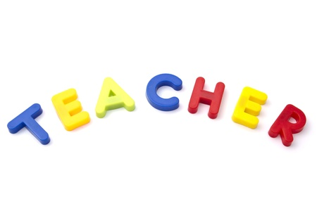 Letter magnets  teacher closeup on white background  photo