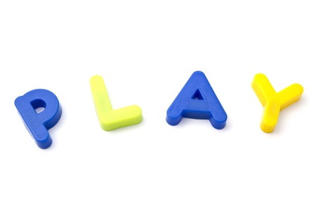 learing: Letter magnets  play closeup on white background  Stock Photo