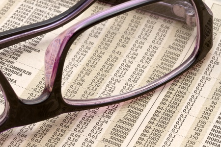 Analyzing the stock market with reading glasses Stock Photo - 13706242