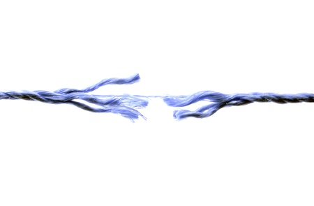 Broken rope isolated on white background photo