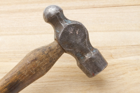 Old hammer closeup on wood background  photo