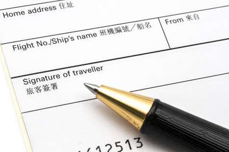 Arrival card and pen closeup Stock Photo - 15003139