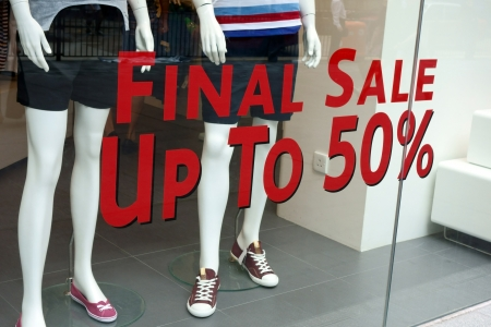 Final sale sign on the fashion shop's window       Stock Photo - 14987223