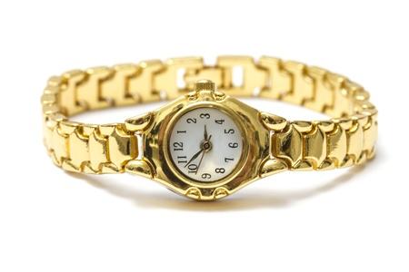 Woman golden wrist watch isolated on white background  photo