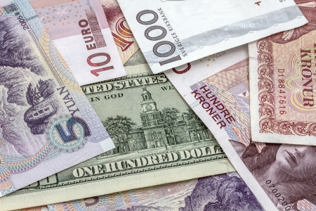 Background of different currencies closeup photo