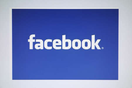 Facebook logo displayed on s computer screen Editorial