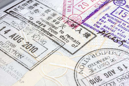 customs official: Background of passport stamps closeup