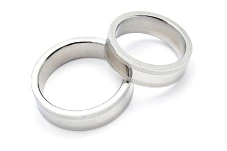 永遠に愛の白い背景で隔離の結婚指輪 写真素材