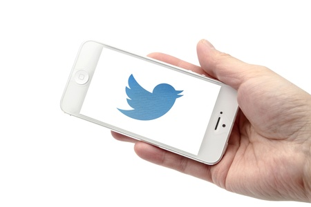 iphone 5 with twitter bird isolated on white background
