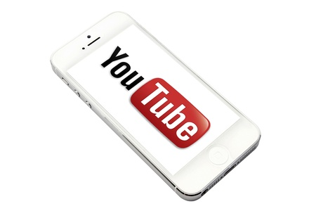 displayed: You Tube logo displayed on a iPhone 5 screen