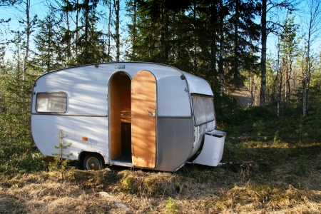 Vintage caravan in the forest Stock Photo