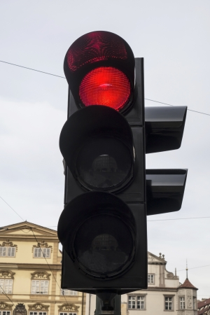 Red color on the traffic light in Prague photo