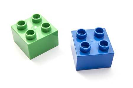 Colorful building blocks closeup on white background  photo