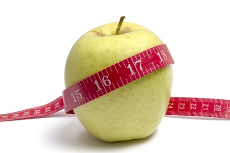 Apple diet.Green apple and tape measure photo