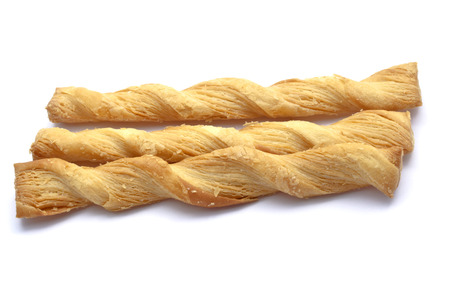 Butter salted twists closeup on white background photo