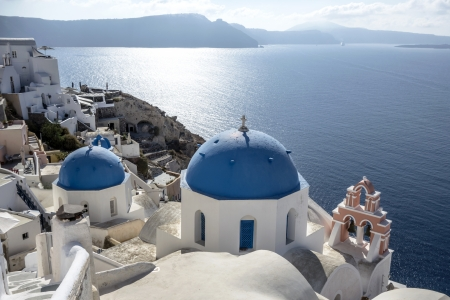 Blue and white church of Oia village ,Santorini, Greece  photo