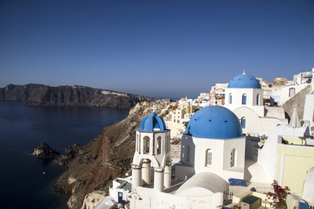 Blue and white church of Oia village, Santorini ,Greece photo