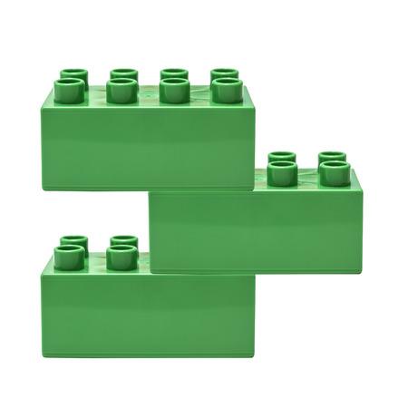 bioedilizia: Verde blocco edificio isolato su bianco Archivio Fotografico