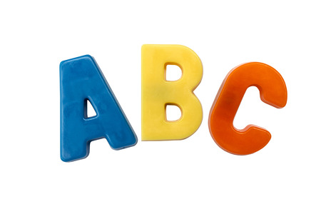 Letter magnets A B C isolated on white photo
