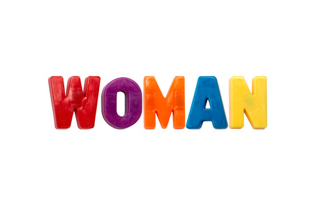 learing: Letter magnets WOMAN isolated on white
