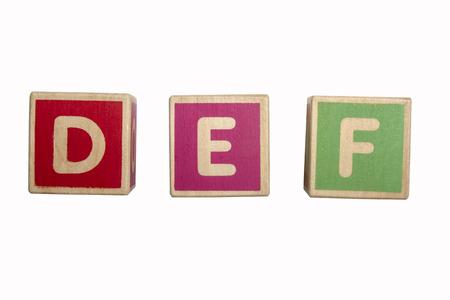 def: Alphabet blocks DEF isolated on white background