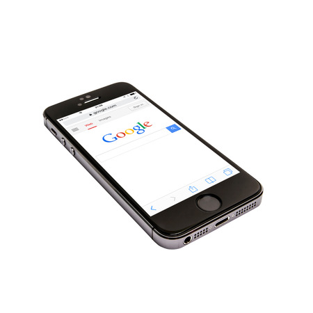 Google website displayed on a iphone 5s screen