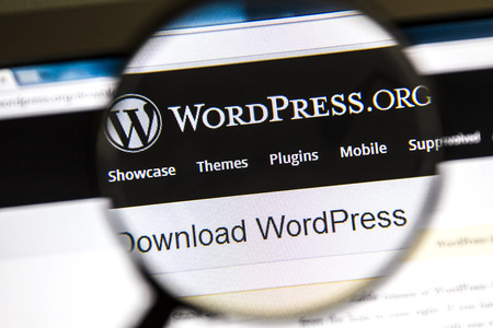 Ostersund, Sweden - August 3, 2014  Close up of Wordpress website under a magnifying glass  WordPress is a free and open source blogging tool