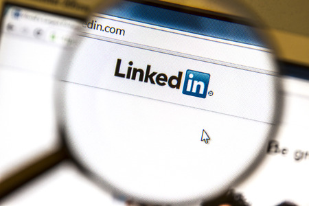 Ostersund, Sweden -August 3, 2014   Linkedin website under a magnifying glass   Linkedin is a business oriented social networking website   報道画像
