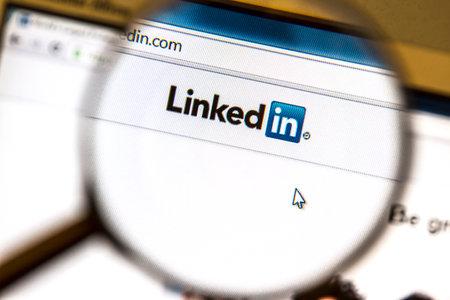 Ostersund, Sweden -August 3, 2014   Linkedin website under a magnifying glass   Linkedin is a business oriented social networking website