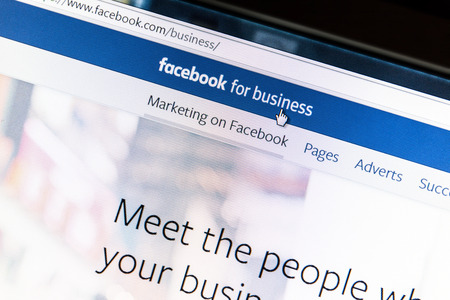 advertise: Close up of Facebook for business webpage on a computer screen. Facebook is the largest social media network on the web.