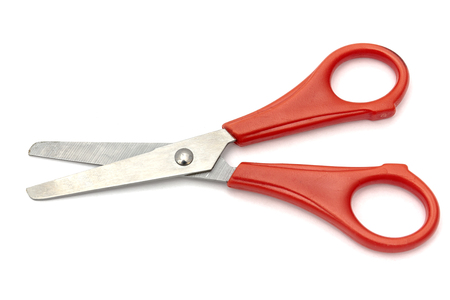 handled: Red handled scissors isolated on white background