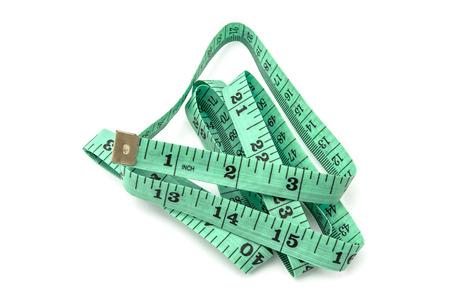 Green tape measure on white background Imagens