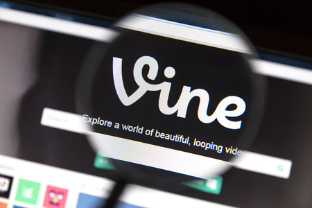 video sharing: Vine website under a magnifying glass. Vine is a short-form video sharing service.