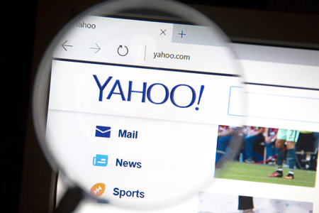 yahoo: ahoo website under a magnifying glass