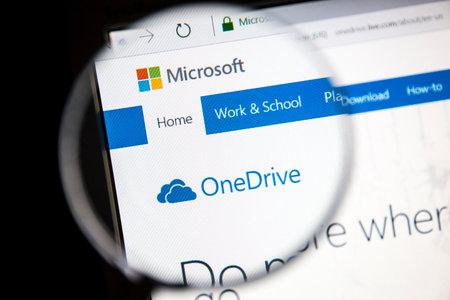 msn: Microsoft OneDrive website under a magnifying glass