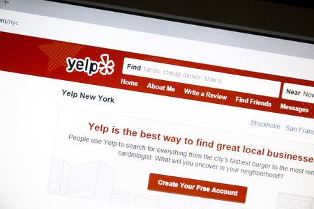 yelp: Yelp website on a computer screen.