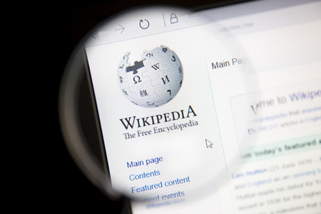 Wikipedia Website Under A Magnifying Glass Stock Photo Picture - Wikipedia royalty free images