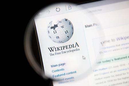 wiki wikipedia: Wikipedia website under a magnifying glass