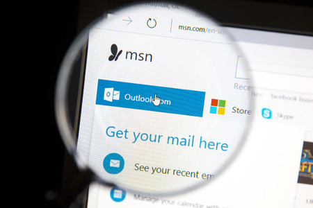 web portal: Ostersund, Sweden - June 27, 2016: Msn website under a magnifying glass. Msn  is a web portal and related collection of Internet services and apps for Windows provided by Microsoft